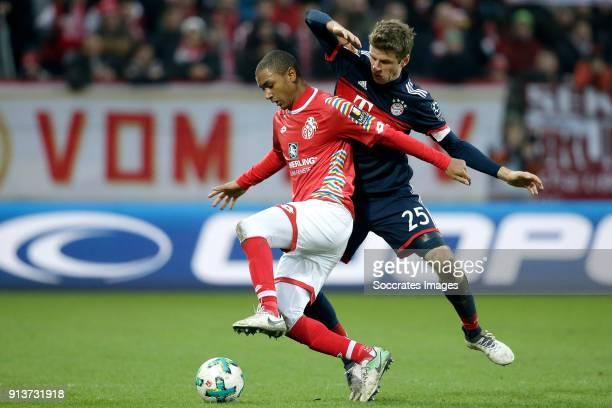 Abdou Diallo of FSV Mainz Thomas Muller of Bayern Munchen during the German Bundesliga match between FSV Mainz v Bayern Munchen at the Opel Arena on...