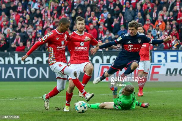 Abdou Diallo of Mainz Alexander Hack of Mainz Goalkeeper Robin Zentner of Mainz and Thomas Mueller of Muenchen battle for the ball during the...