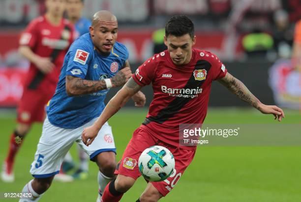 Abdou Diallo of Mainz and Charles Aranguiz of Leverkusen battle for the ball during the Bundesliga match between Bayer 04 Leverkusen and 1 FSV Mainz...