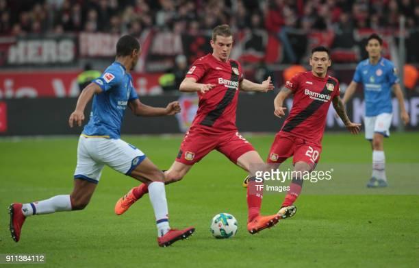 Abdou Diallo of Mainz and Lars Bender of Leverkusen battle for the ball during the Bundesliga match between Bayer 04 Leverkusen and 1 FSV Mainz 05 at...