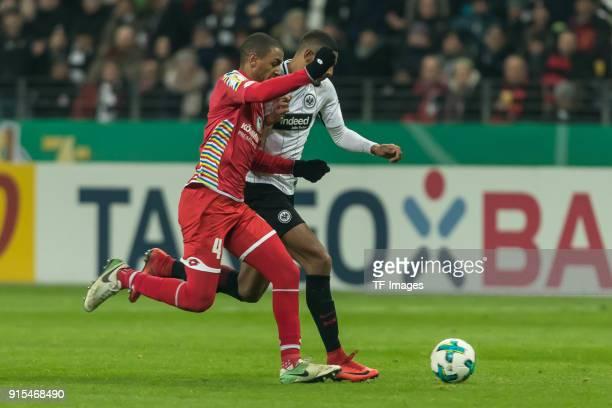 Abdou Diallo of Mainz and Sebastien Haller of Frankfurt battle for the ball during the DFB Cup match between Eintracht Frankfurt and 1 FSV Mainz 05...