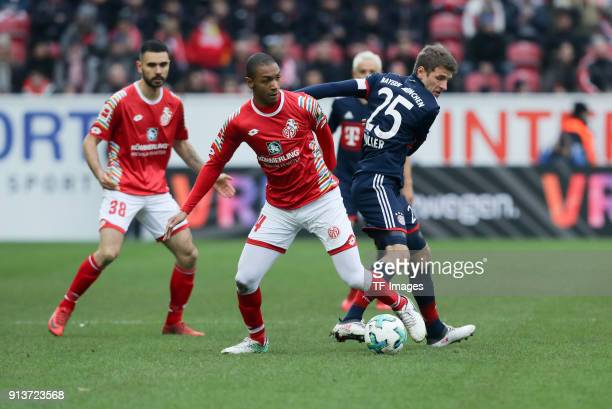 Abdou Diallo of Mainz and Thomas Mueller of Muenchen battle for the ball during the Bundesliga match between 1 FSV Mainz 05 and FC Bayern Muenchen at...