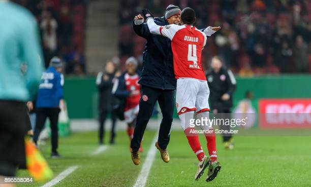 Abdou Diallo of Mainz celebrates the second goal for his team with his teammates during the DFB Cup match between 1 FSV Mainz 05 and VfB Stuttgart at...