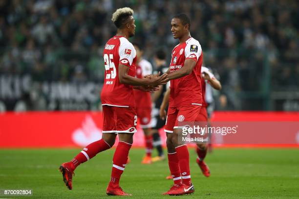 Abdou Diallo of Mainz celebrates with JeanPhilippe Gbamin of Mainz after he scored a goal to make it 01 during the Bundesliga match between Borussia...