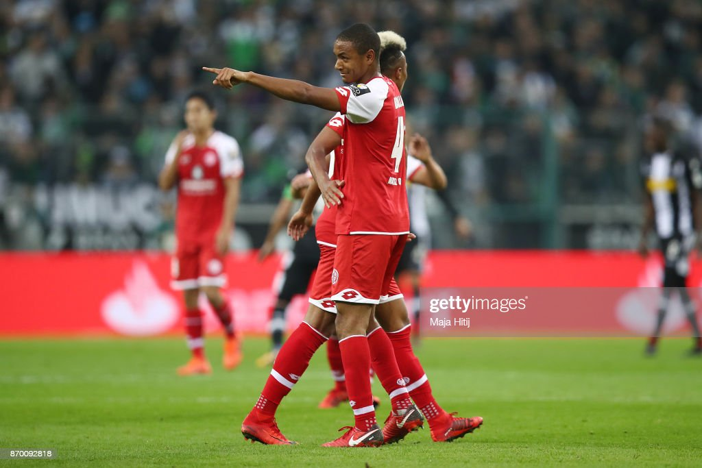 Abdou Diallo of Mainz (front) celebrates with Jean-Philippe Gbamin of Mainz after he scored a goal to make it 0:1 during the Bundesliga match between Borussia Moenchengladbach and 1. FSV Mainz 05 at Borussia-Park on November 4, 2017 in Moenchengladbach, Germany.