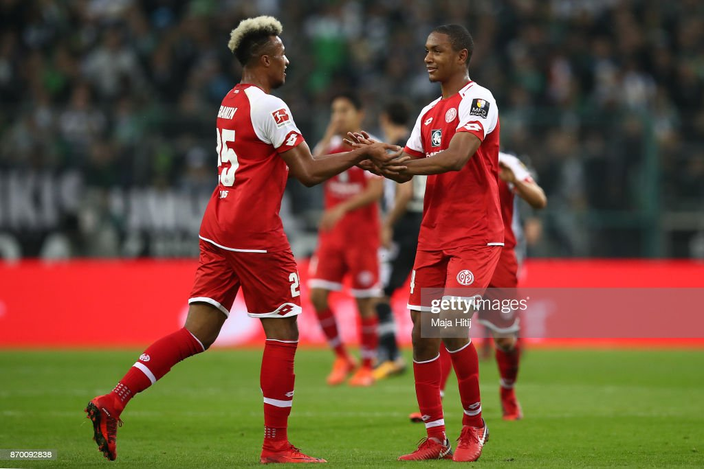 Abdou Diallo of Mainz (r) celebrates with Jean-Philippe Gbamin of Mainz after he scored a goal to make it 0:1 during the Bundesliga match between Borussia Moenchengladbach and 1. FSV Mainz 05 at Borussia-Park on November 4, 2017 in Moenchengladbach, Germany.