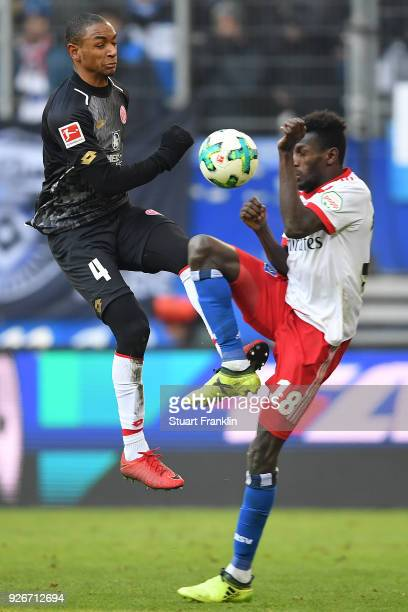 Abdou Diallo of Mainz fights for the ball with Bakery Jatta of Hamburg during the Bundesliga match between Hamburger SV and 1 FSV Mainz 05 at...