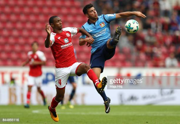 Abdou Diallo of Mainz fights for the ball with Kevin Volland of Bayer Leverkusen during the Bundesliga match between 1 FSV Mainz 05 and Bayer 04...