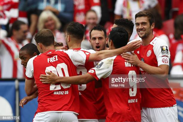 Abdou Diallo of Mainz is celebrates by his team mates after he scored his teams second goal to make it 21 during the Bundesliga match between 1 FSV...