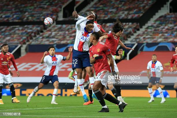 Abdou Diallo of PSG challenges for a header during the UEFA Champions League Group H stage match between Manchester United and Paris Saint-Germain at...