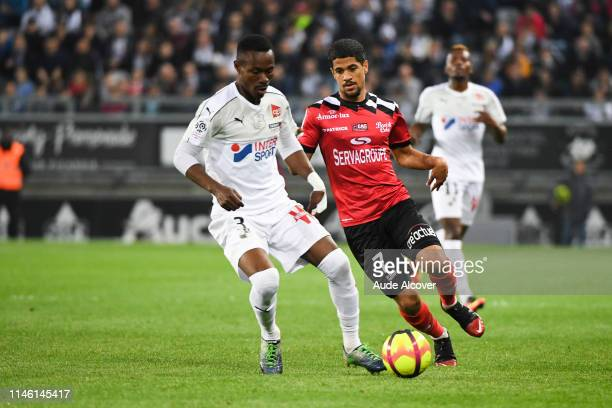 Abdou Kaled Adenon of Amiens and Ludovic Blas during the Ligue 1 match between Amiens Sporting Club and EA Guingamp on May 24 2019 in Amiens France