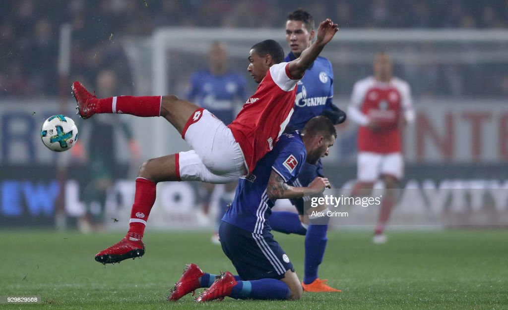 Abdou Lakhad Diallo of Mainz is challenged by Guido Burgstaller of Schalke during the Bundesliga match between 1. FSV Mainz 05 and FC Schalke 04 at Opel Arena on March 9, 2018 in Mainz, Germany.