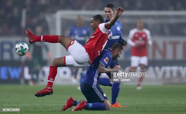 Abdou Lakhad Diallo of Mainz is challenged by Guido Burgstaller of Schalke during the Bundesliga match between 1. FSV Mainz 05 and FC Schalke 04 at...