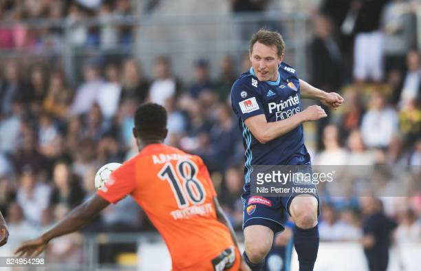 Abdoul Razak of Athletic FC Eskilstuna and Kim Kallstrom of Djurgardens IF competes for the ballduring the Allsvenskan match between Athletic FC...