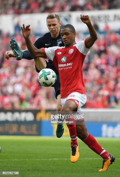 AbdouLakhad Diallo of Mainz is challenged by Ondrej Duda of Berlin during the Bundesliga match between 1 FSV Mainz 05 and Hertha BSC at Opel Arena on...