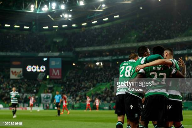 Abdoulay Diaby of Sporting CP celebrates scoring Sporting CP fourth goal with his team mates during the Liga NOS round 12 match between Sporting CP...