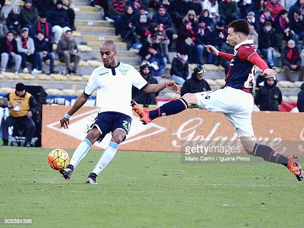 Abdoulay Konko 29 of SS Lazio L kicks the ball oast Matteo Brighi 33 of Bologna FC during the Serie A match between Bologna FC and SS Lazio at Stadio...
