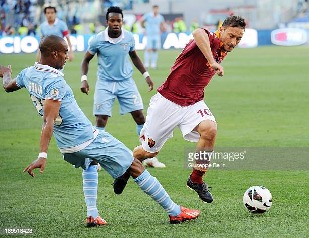 Abdoulay Konko of Lazio and Francesco Totti of Roma in action during the TIM cup final match between AS Roma v SS Lazio at Stadio Olimpico on May 26,...