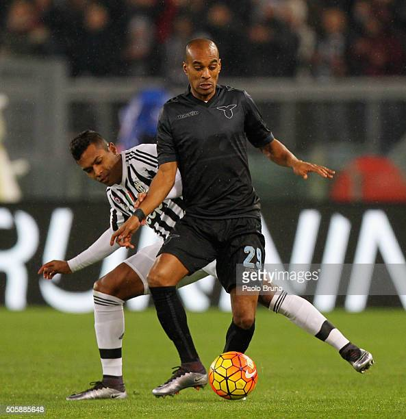 Abdoulay Konko of SS Lazio competes for the ball with Alex Sandro of Juventus FC during the TIM Cup match between SS Lazio and Juventus FC at Stadio...