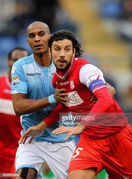 Abdoulay Konko of SS Lazio competes for the ball with Cristian Zaccardo of Carpi FC during the Serie A match between SS Lazio and Carpi FC at Stadio...