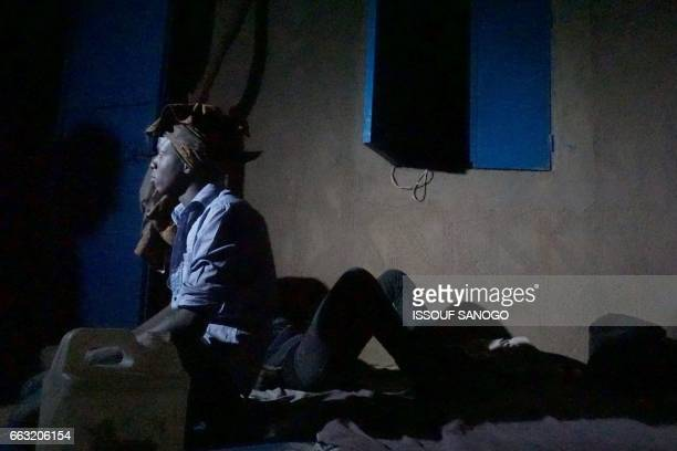 Abdoulaye a young senegalese man waits in a 'ghetto' of the city of Agadez northern Niger on March 31 in order to reach Libya and try to cross the...
