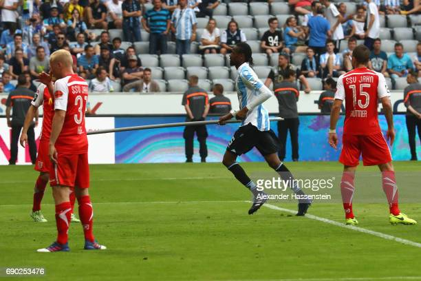 Abdoulaye Ba of 1860 Muenchen runs with pole which is throwed to the field of play the Second Bundesliga Playoff second leg match betweenTSV 1860...