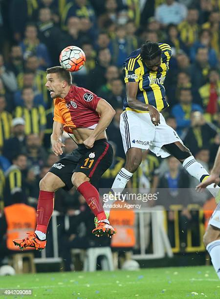 Abdoulaye Ba of Fenerbahce in action against Podolski of Galatasaray during the Turkish Spor Toto Super League football match between Fenerbahce and...