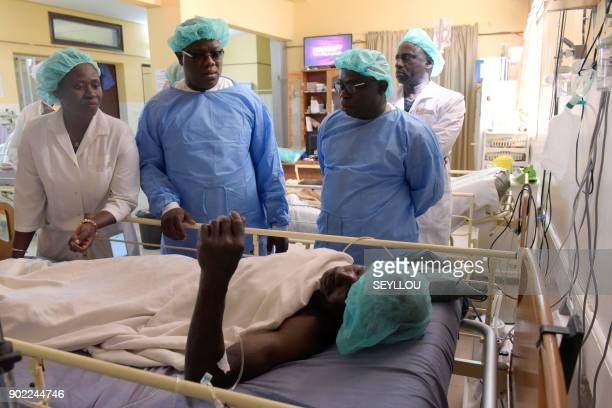 Abdoulaye Balde the mayor of the southern regional capital of Ziguinchor visits a victim of an attack by armed men in the Bayotte forest on January 7...