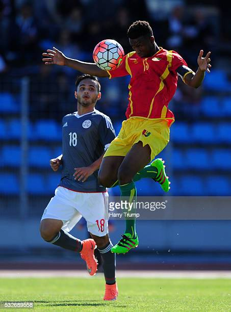 Abdoulaye Cisse of Guinea challenges for the high ball with David Colman Escobar of Paraguay during the Toulon Tournament match between Guinea and...