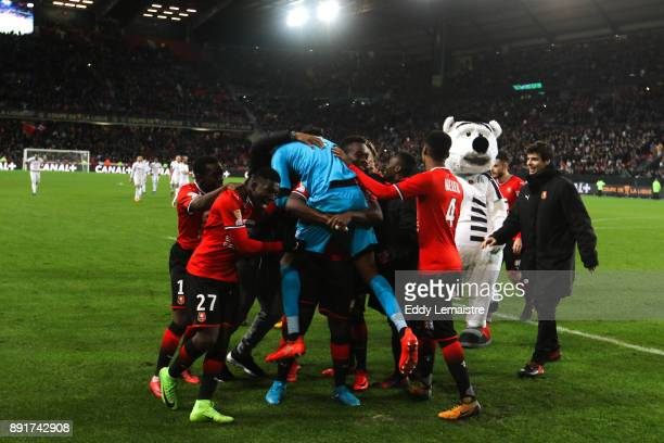 Abdoulaye Diallo Goalkeeper of Rennes and his teammate celebrate after defeating Marseille during the french League Cup match Round of 16 between...