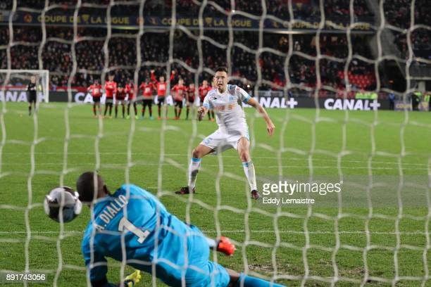 Abdoulaye Diallo Goalkeeper of Rennes stops the shoot of Lucas Ocampos of Marseille during the penalties session during the french League Cup match...