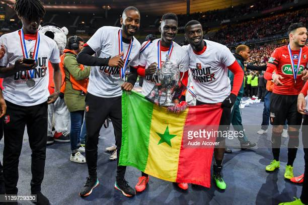 Abdoulaye Diallo Ismaila Sarr and M'Baye Niang of Rennes celebrate victory during the French national cup final match between Rennes and Paris Saint...
