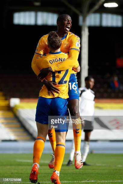 Abdoulaye Doucouré of Everton celebrates after scoring their sides third goal with Lucas Digne of Everton during the Premier League match between...