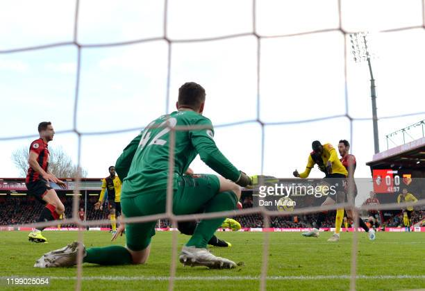 Abdoulaye Doucour of Watford scores his sides first goal past Mark Travers of AFC Bournemouth during the Premier League match between AFC Bournemouth...