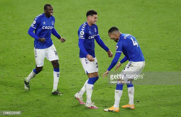 Abdoulaye Doucoure, Ben Godfrey and Mason Holgate of Everton celebrate following their team's victory in the Premier League match between Sheffield...