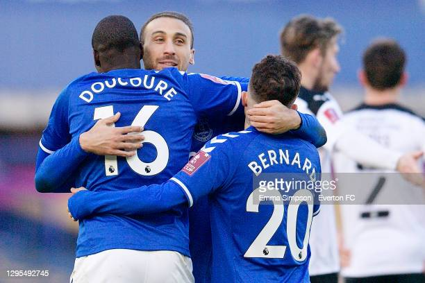 Abdoulaye Doucoure celebrates his goal with Cenk Tosun and Bernard of Everton during the FA Cup Third Round match between Everton and Rotherham...
