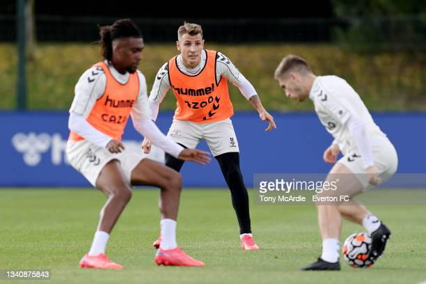 Abdoulaye Doucoure, Lucas Digne and Jonjoe Kenny during the Everton Training Session at USM Finch Farm on September 16 2021 in Halewood, England.