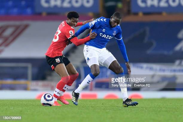 Abdoulaye Doucoure of Everton and Nathan Tella challenge for the ball during the Premier League match between Everton and Southampton at Goodison...