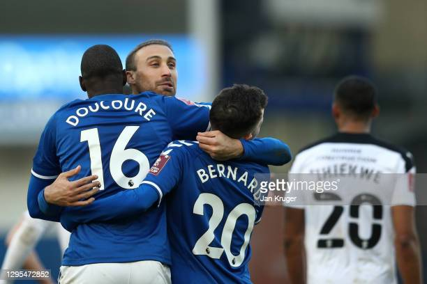Abdoulaye Doucoure of Everton celebrates with teammates Cenk Tosun and Bernard after scoring his team's second goal during the FA Cup Third Round...
