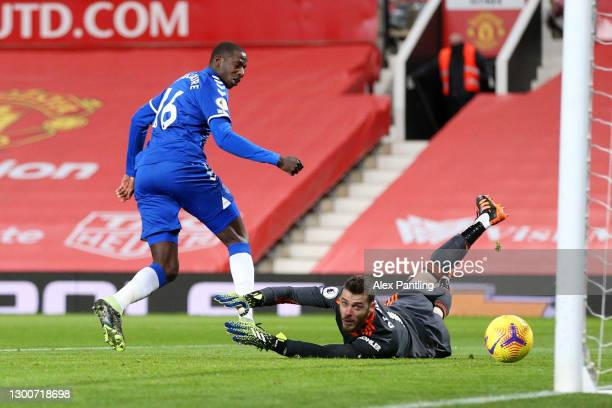 Abdoulaye Doucoure of Everton scores their team's first goal past David De Gea of Manchester United during the Premier League match between...