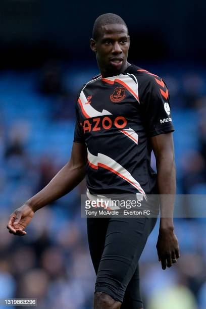 Abdoulaye Doucoure of Everton warms up before the Premier League match between Manchester City and Everton at the Etihad Stadium on May 23, 2021 in...