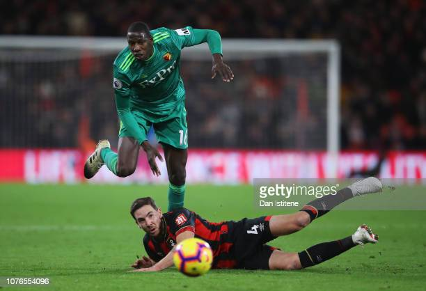 Abdoulaye Doucoure of Watford and Dan Gosling of AFC Bournemouth battle for the ball during the Premier League match between AFC Bournemouth and...