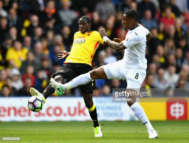 Abdoulaye Doucoure of Watford and Leroy Fer of Swansea City battle for possession during the Premier League match between Watford and Swansea City at...