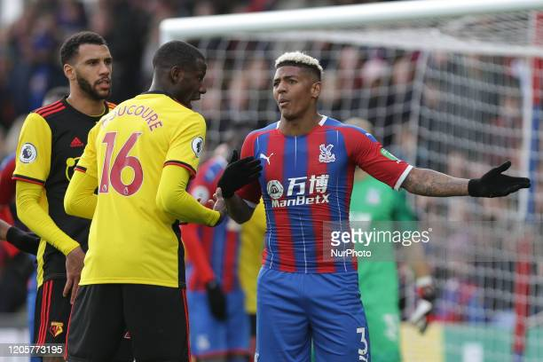 Abdoulaye Doucoure of Watford and Patrick Van Aanholt of Crystal Palace arguing during the Premier League match between Crystal Palace and Watford at...
