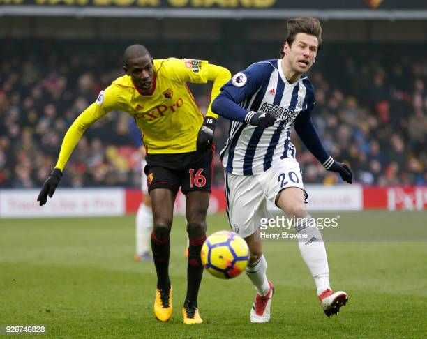 Abdoulaye Doucoure of Watford battles for possesion with Grzegorz Krychowiak of West Bromwich Albion during the Premier League match between Watford...