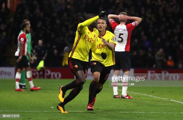 Abdoulaye Doucoure of Watford celebrates after scoring his sides second goal with Richarlison de Andrade of Watford during the Premier League match...