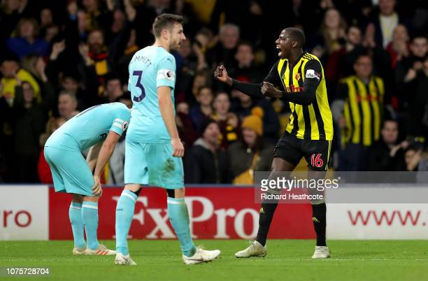 Abdoulaye Doucoure of Watford celebrates after scoring his team's first goal as Paul Dummett of Newcastle United reacts during the Premier League...