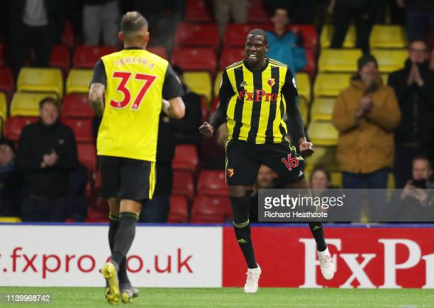 Abdoulaye Doucoure of Watford celebrates after scoring his team's first goal during the Premier League match between Watford FC and Fulham FC at...