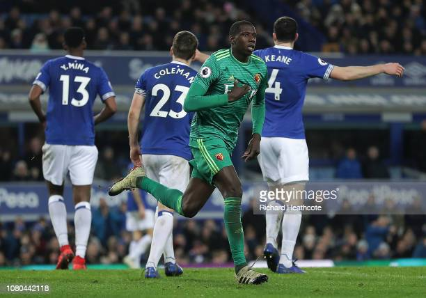 Abdoulaye Doucoure of Watford celebrates scoring a header during the Premier League match between Everton FC and Watford FC at Goodison Park on...