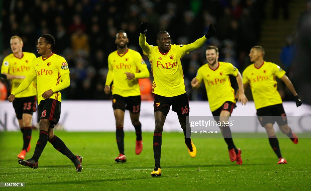 Abdoulaye Doucoure of Watford celebrates the own goal scored by Kasper Schmeichel of Leicester City with team mates during the Premier League match between Watford and Leicester City at Vicarage Road on December 26, 2017 in Watford, England.